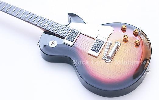 RGM09 Slash Sunburst Guns n Roses Guitarra en Miniatura: Amazon ...