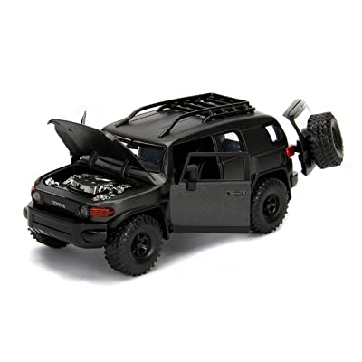 Toyota FJ Cruiser with Roof Rack Charcoal Gray Metallic Just Trucks 1/24 Diecast Model Car by Jada 99318: Toys & Games