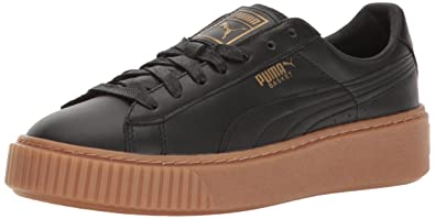 ef833fa959ee Puma Women s Basket Platform Core Fashion Sneaker Black Gold  Amazon ...