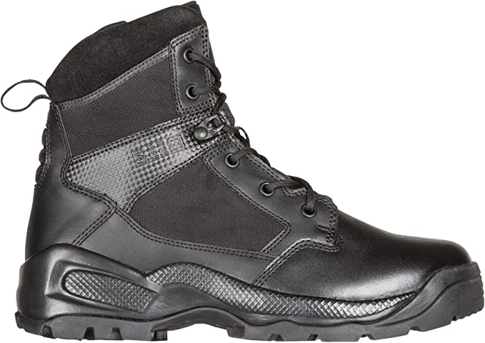 Image of a tactical boot for men, facing right, with rugged design outsole, on a white background.