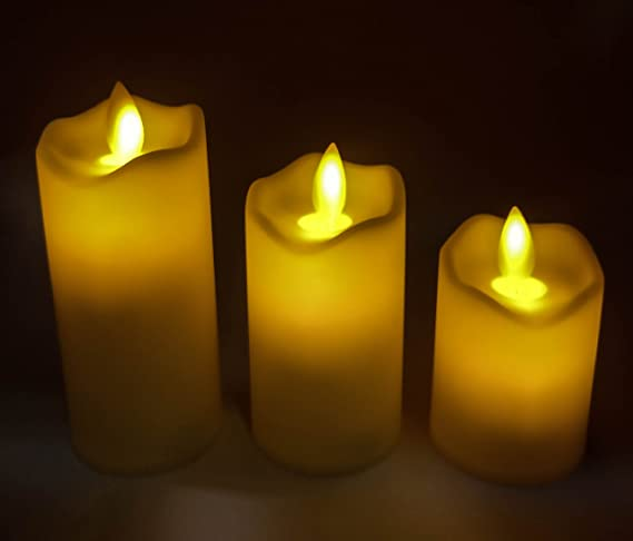 GOYAL® Christmas Special Flameless LED flickering swinging yellow candle (Set of 3)
