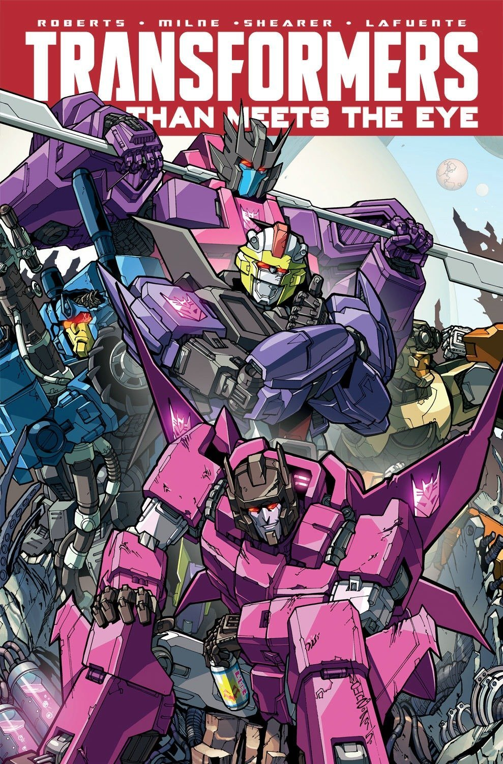 Transformers: More Than Meets The Eye Volume 9 Paperback – May 17, 2016