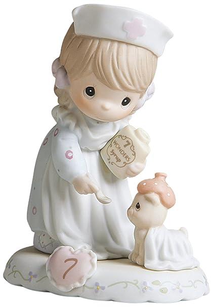 amazon com precious moments brunette girl nurse age 7 figurine