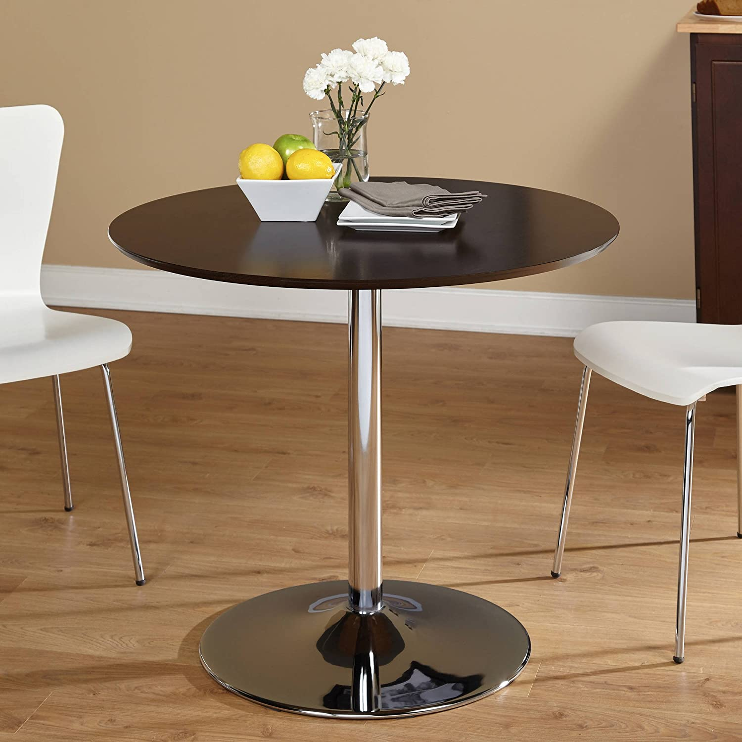 Elegant table classic vintage styling updated with an oh so modern espresso finish the chrome plated pedestal base supports a round table that is the