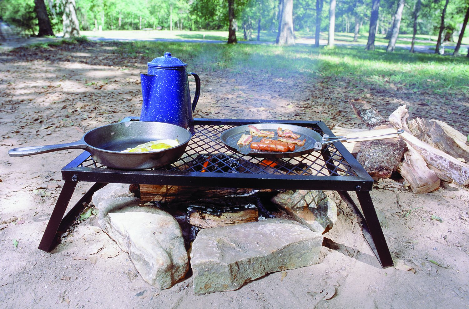 Heavy Duty Over Fire Camp Grill made our list of Campfire Cooking Equipment You Can't Live Without with the best tools, accessories, utensils and cookware for your camp cooking creations!
