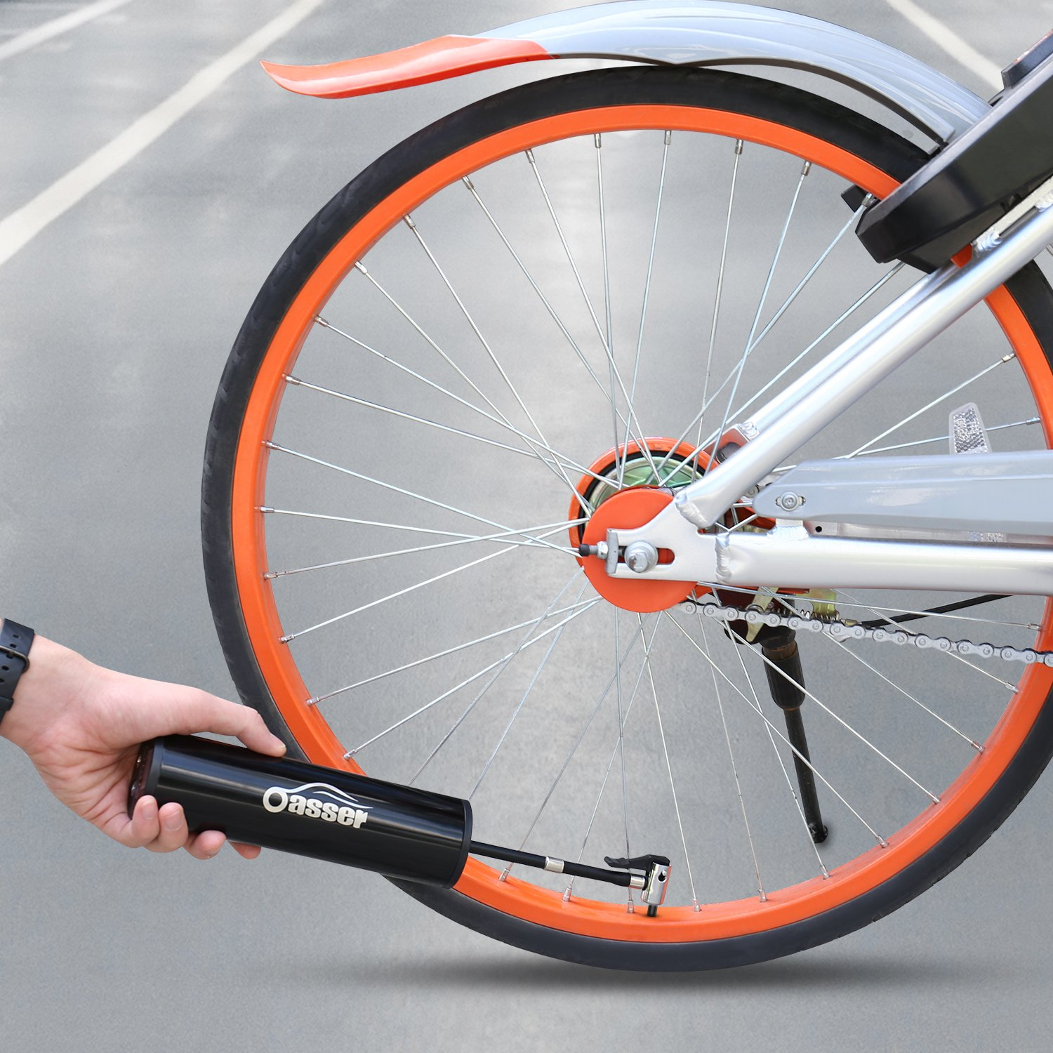 image of oasser pump airing up bicycle tire