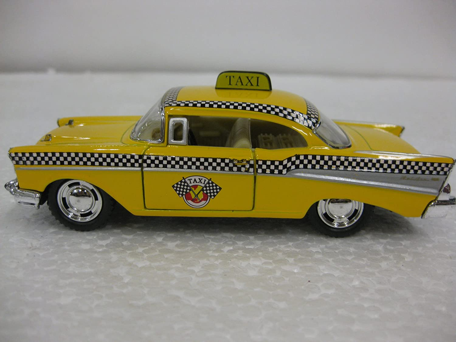 Diecast 1957 Chevrolet Bel Air Taxi 1 40 Scale with Opening Doors And Pull Back Action Manufactured By Kinsmart