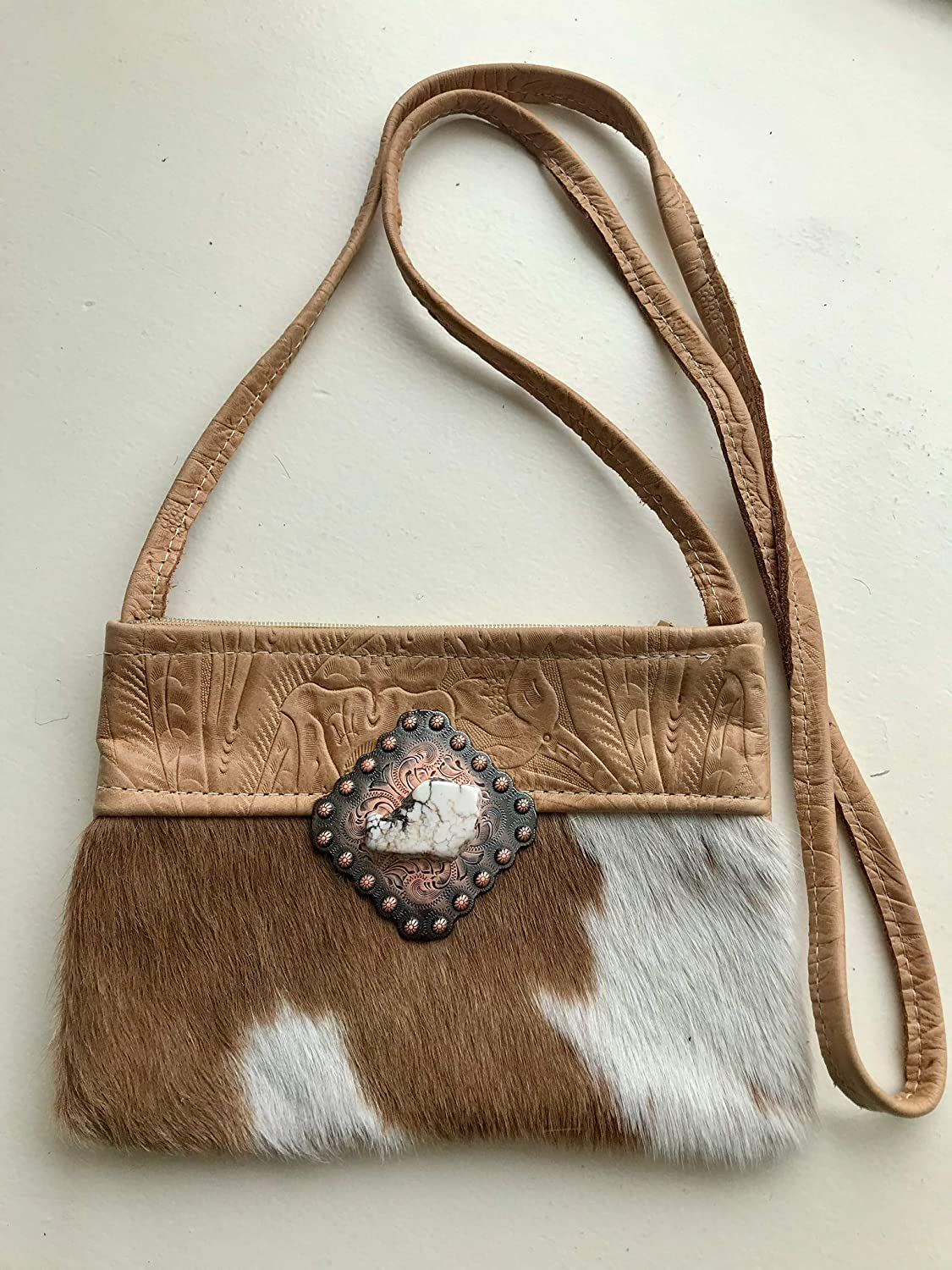 Brown and white cowhide cross body bag