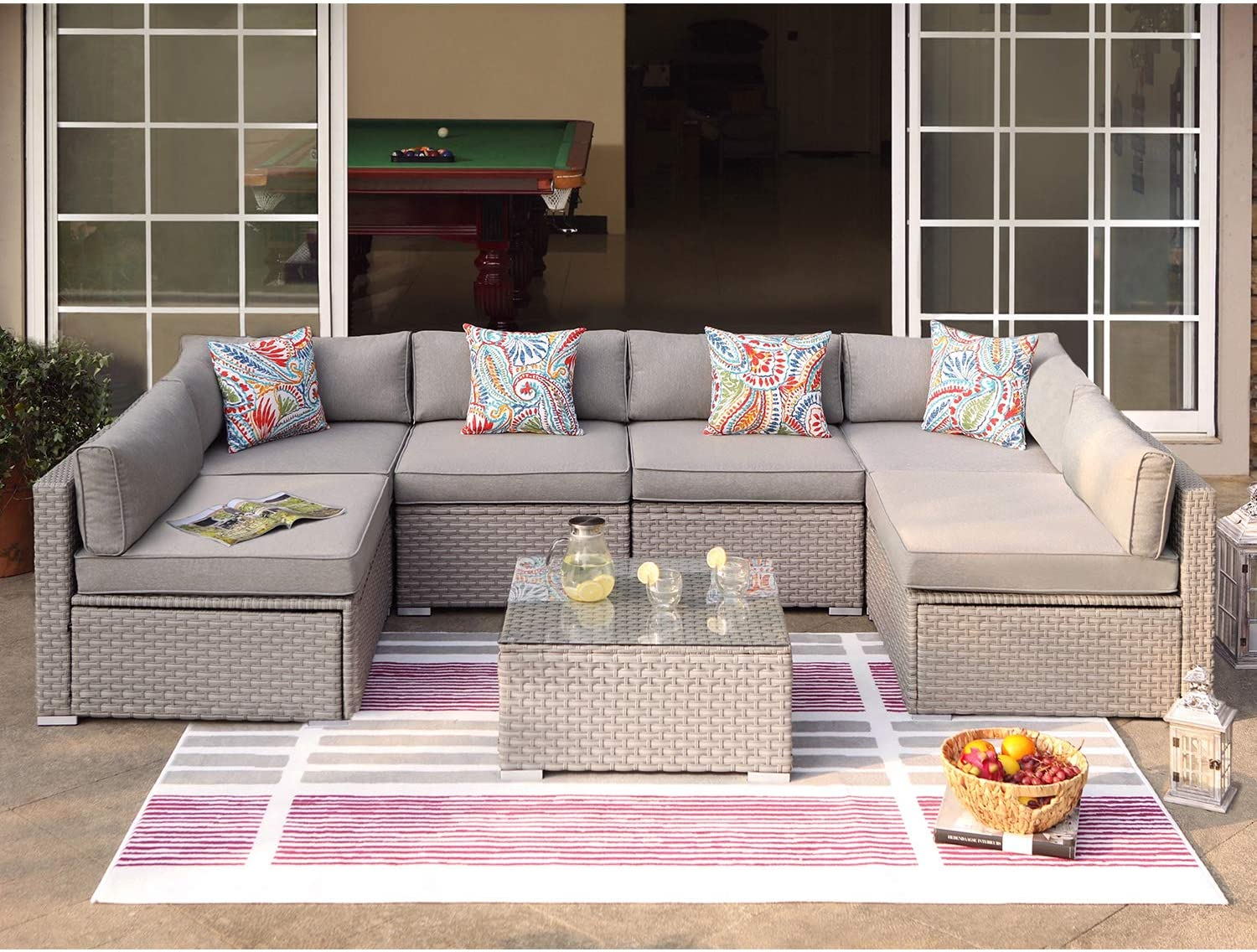 COSIEST 7-Piece Outdoor Furniture Set Warm Gray Wicker Sectional Sofa w Thick Cushions, Glass Coffee Table, 6 Floral Fantasy Pillows for Garden, Pool, Backyard
