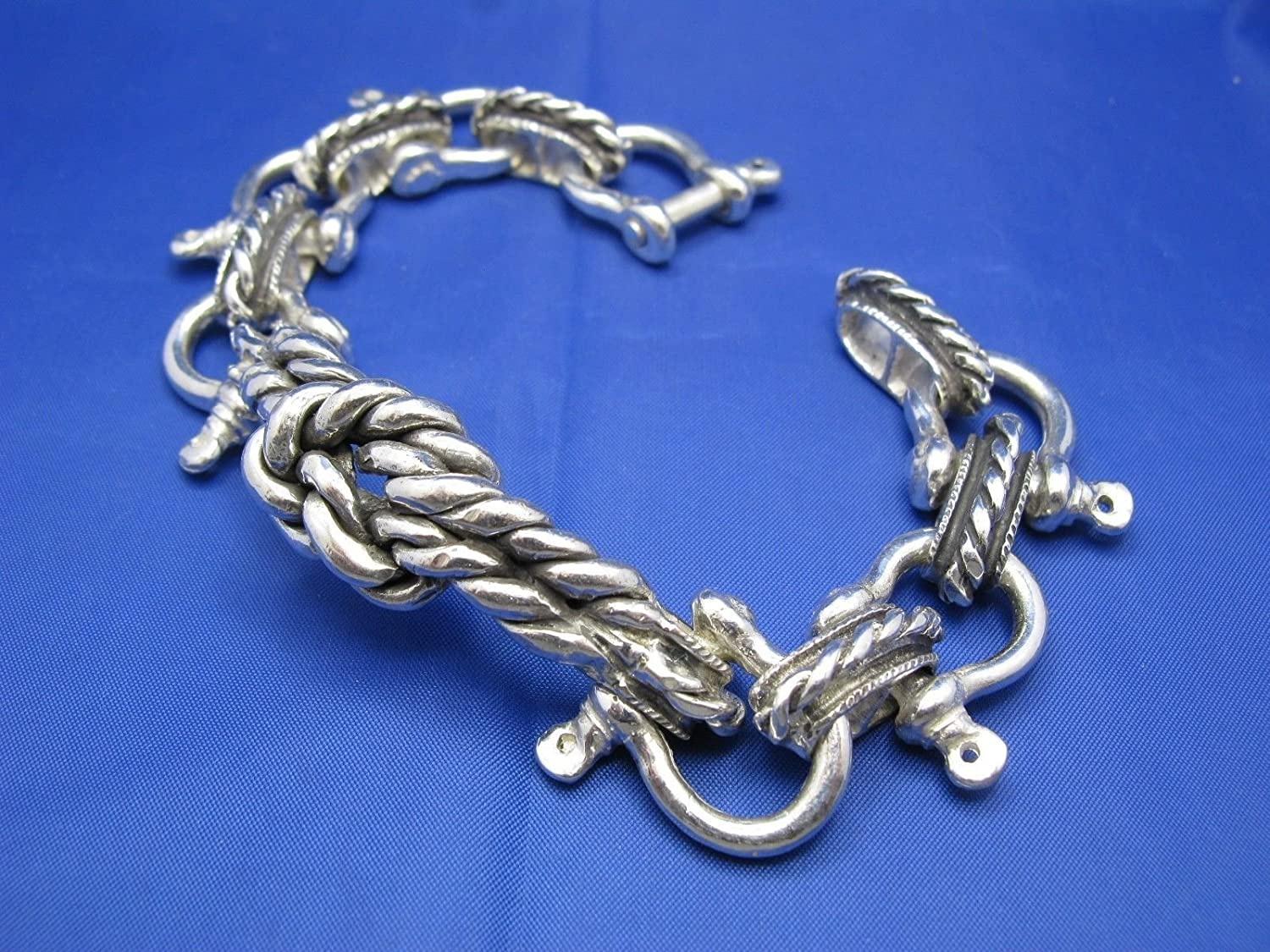 Deluxe Adult Costumes - Pirate men's handmade sterling silver wide nautical shackle bracelet with sailor's knot center.