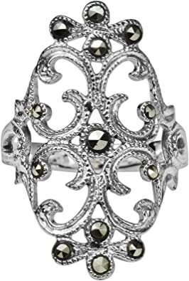 Handmade 925 Sterling Silver ring shell motive with genuine Black Onyx stone.