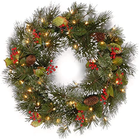 National Tree Company Pre Lit Artificial Christmas Wreath Flocked With Mixed Decorations And Pre Strung White Led Lights Wintry Pine 24 Inch Amazon Co Uk Kitchen Home