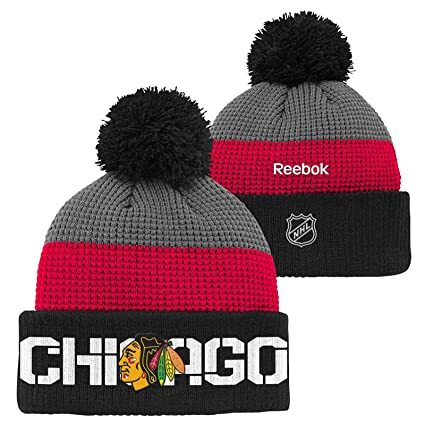 99f19d369 Image Unavailable. Image not available for. Color  Reebok Chicago  Blackhawks Center Ice Waffle Cuffed Pom Knit Hat