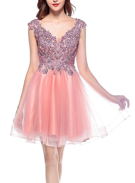 4735f1394 Este vestido corto está elaborado con un forro de poliéster y una falda de  gasa con largo sobre las rodillas. En la parte superior viene con cuentas y  ...