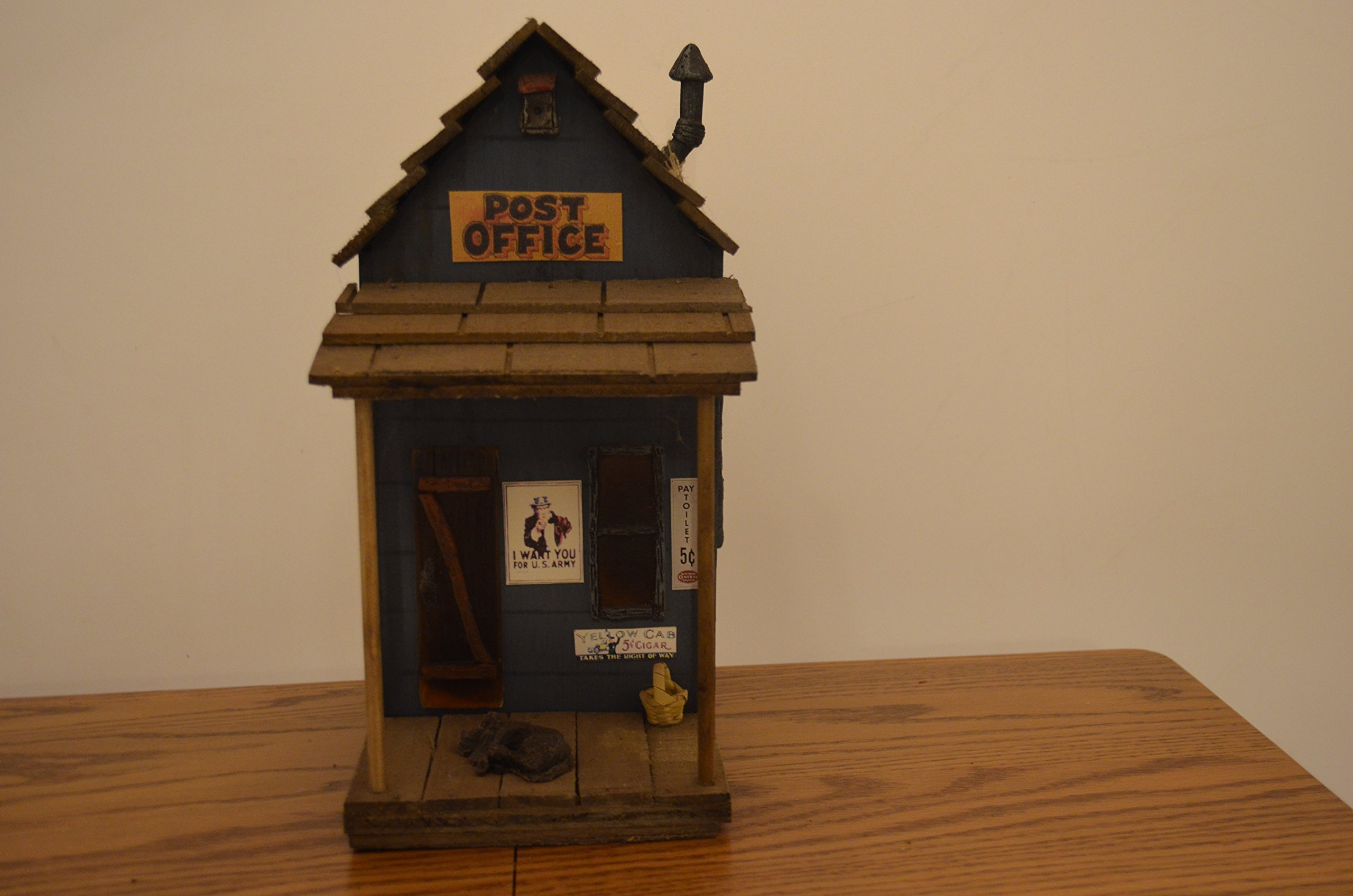 Birdhouse (with Entrance/ Exit Hole in the Front and Access Hole in the Back for Detachable Light to Glow Through the Windows and Doors) Resembling a Wooden Blue Post Office Decorated with Windows, a Door, a Dog, Basket, and Signs. Measurements Are 9 1/4