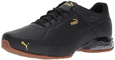PUMA Men's Cell Surin 2 Premium Sneaker, Black-Gold, 7 M US