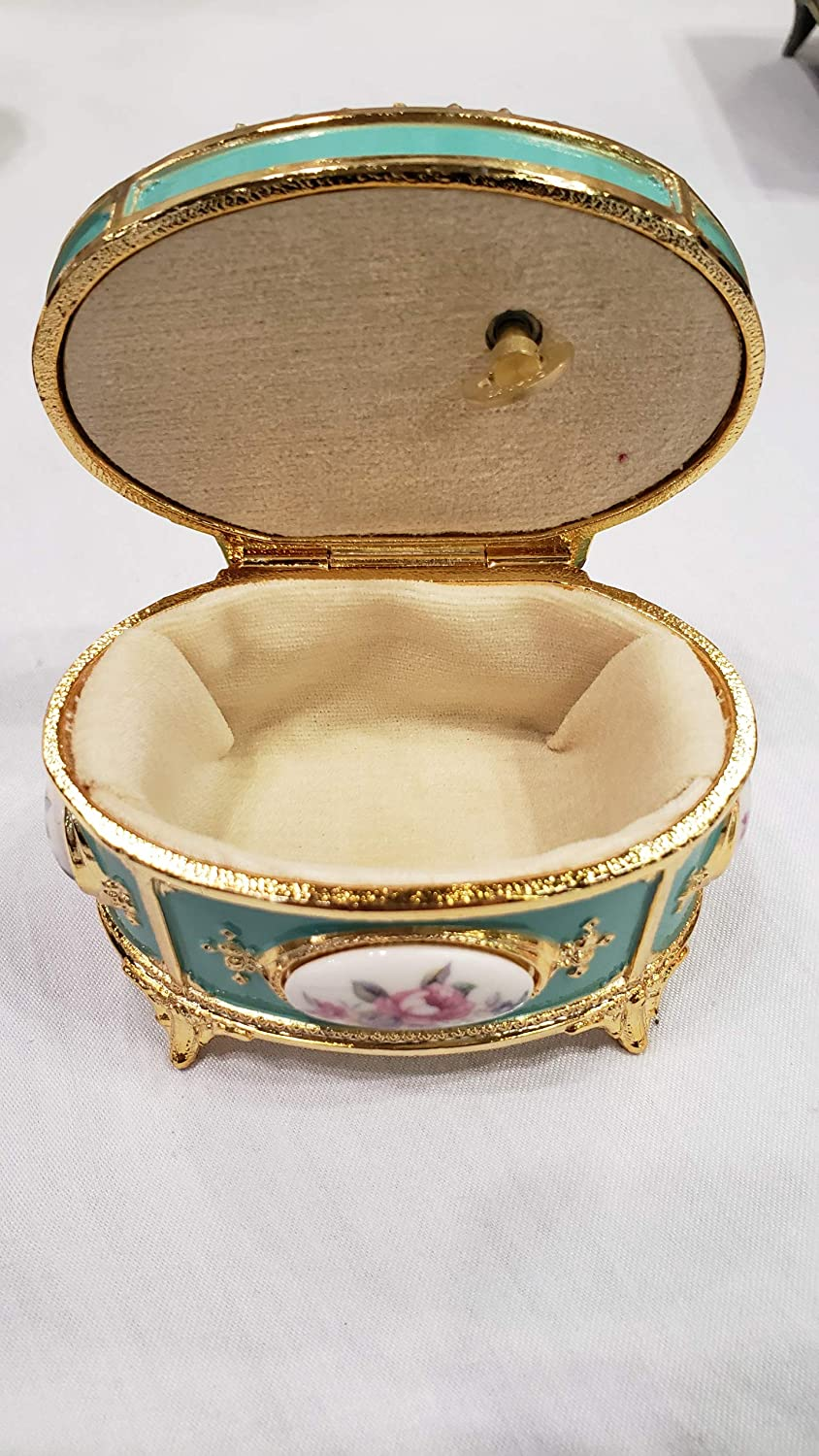 Sea Foam Green Oval Shaped Musical Jewelry Box playing My Heart Will Go On
