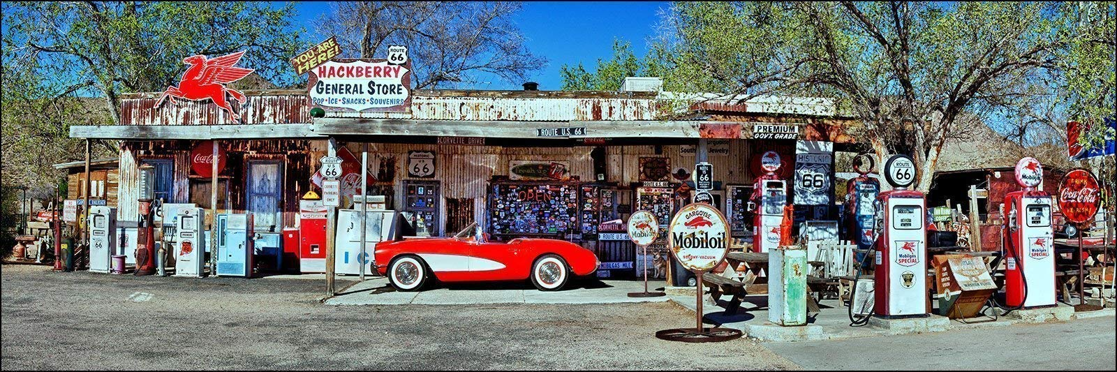 12 x 36 inch panoramic wall art photograph of red vintage corvette and gas station pumps on Rt66 in Hackberry, Arizona.