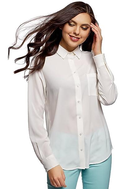 Elegante blusa recta con bolsillo y puños. Ideal para oficina.