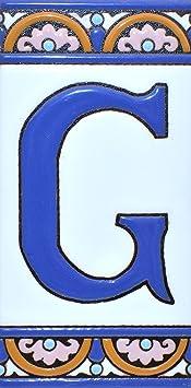 """Image ofLetreros con numeros y letras en azulejo de ceramica policromada, pintados a mano en técnica cuerda seca para placas con nombres, direcciones y señaléctica. Texto personalizable. Diseño ARCO GRANDE 14,9 cm x 7,4 cm. (LETRA """"G"""")"""