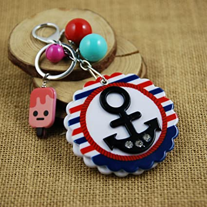Gifts UK - Llavero, diseño de emoticono de Halloween con ...