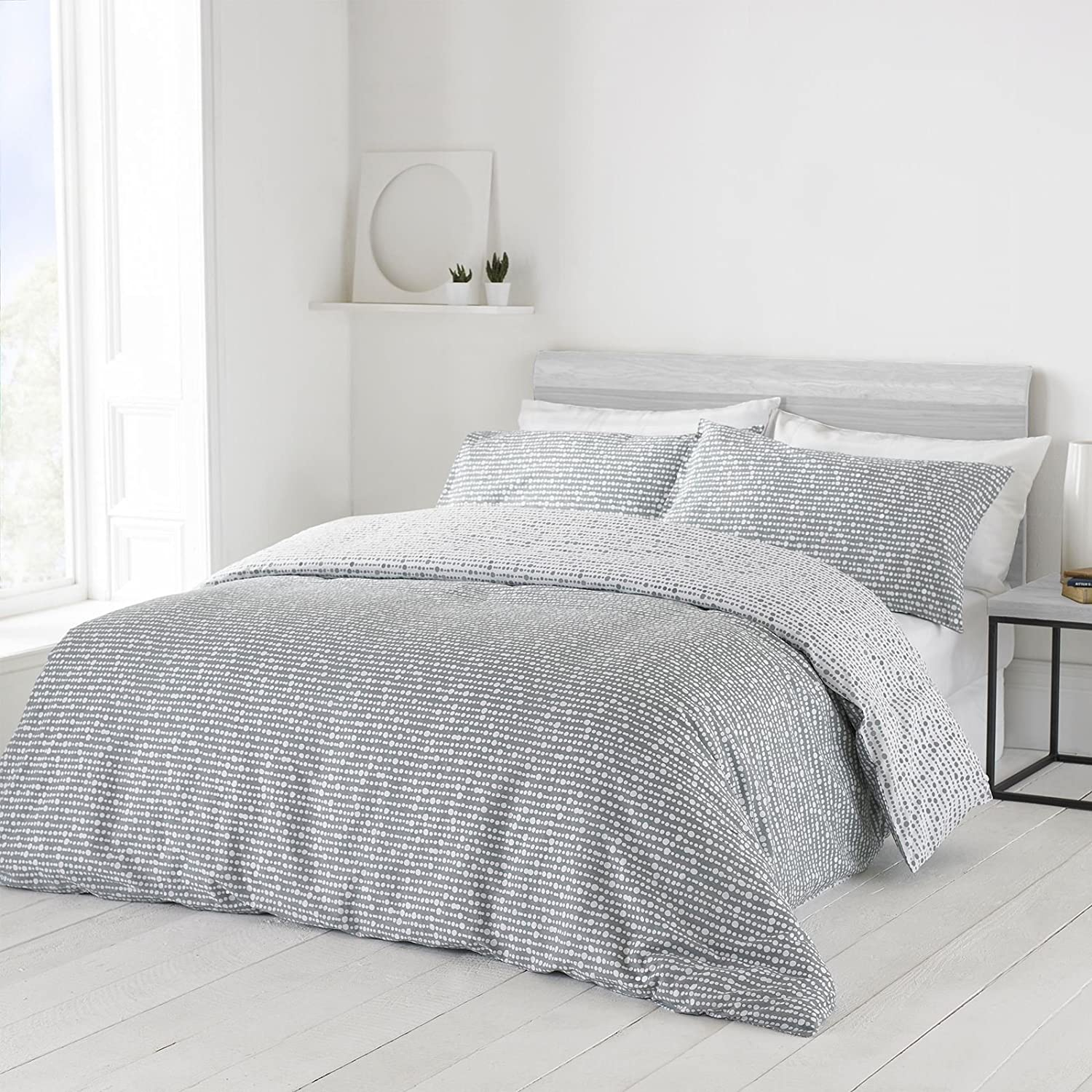 grey and white bed in a bag