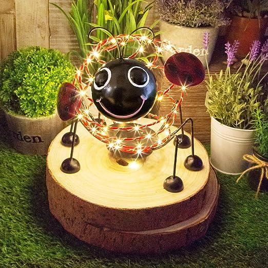 GardenKraft - Alambre Solar con 62 microleds y Efecto de Movimiento en 4D para Decorar el jardín, Red and Black: Amazon.es: Jardín
