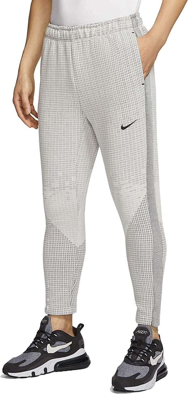 En necesidad de sueño aguja  Nike Sportswear Tech Pack Men's Pants Cj5151-072 at Amazon Men's Clothing  store