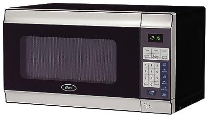 amazon com oster 0 7 cubic foot 700 watt countertop microwave oven rh amazon com