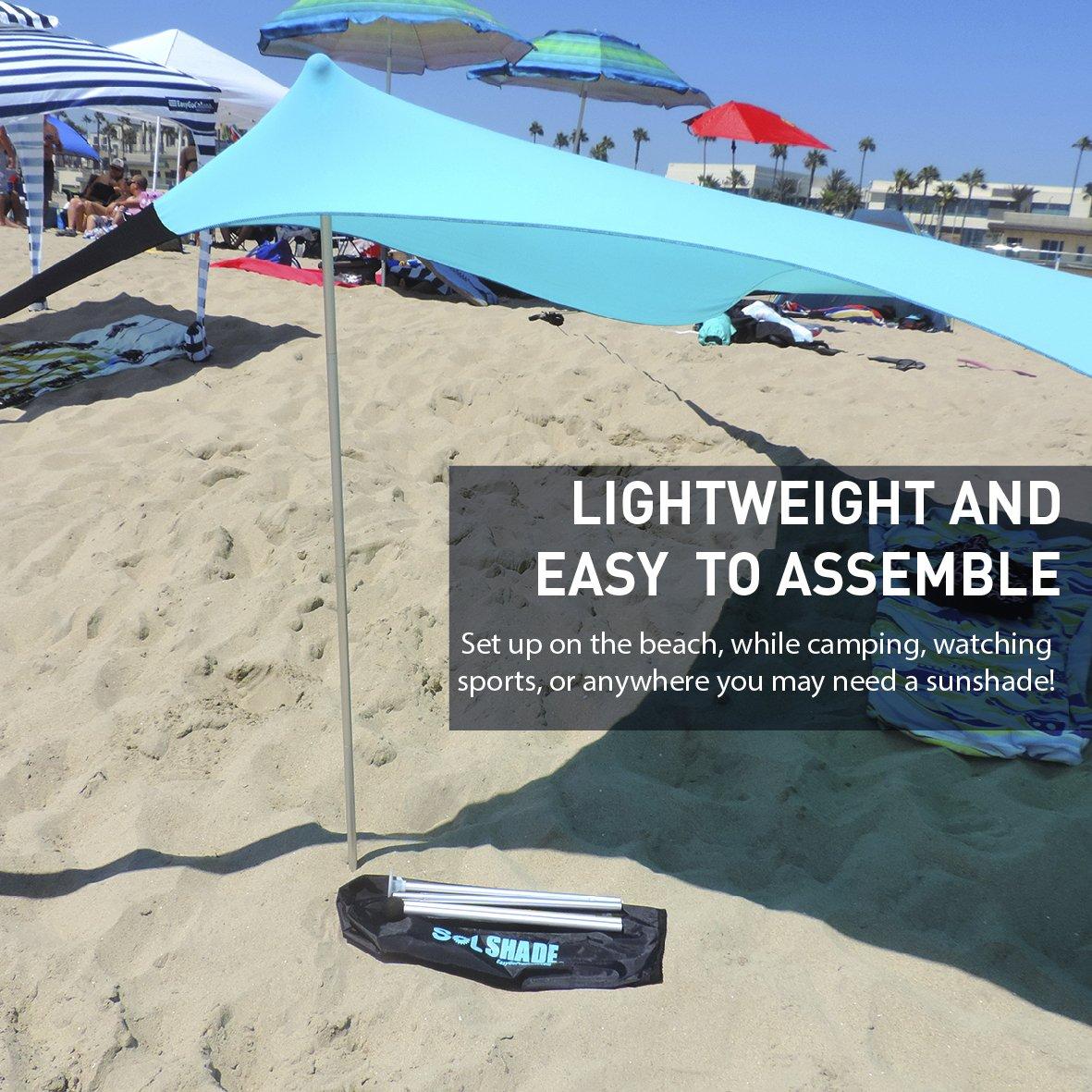 Amazon.com Sol ShadeTM Portable Easy Pop Up Beach Stretch Fabric Sun Shade Tent Canopy Home u0026 Kitchen  sc 1 st  Amazon.com & Amazon.com: Sol ShadeTM Portable Easy Pop Up Beach Stretch Fabric ...