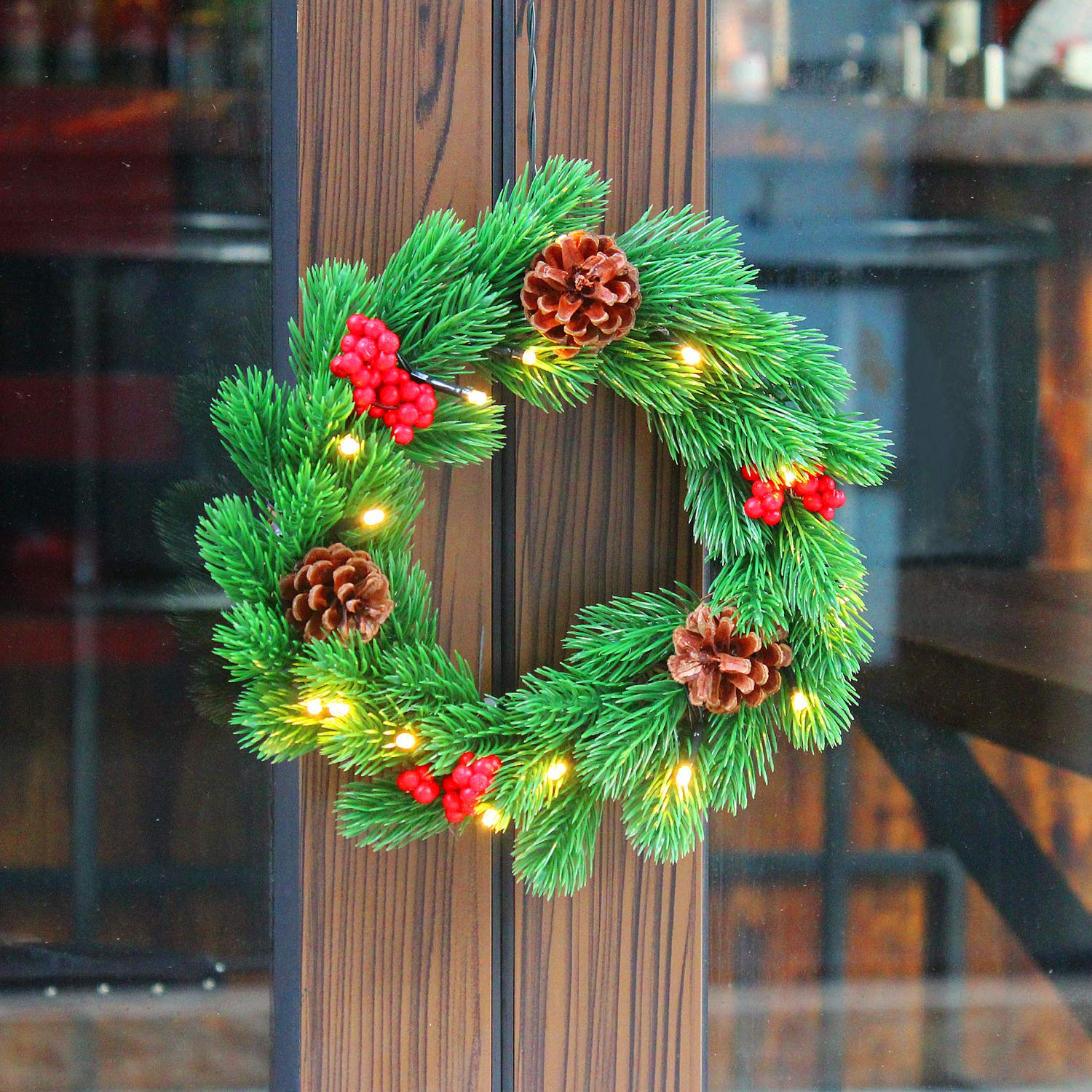 Fanshunlite 11 Inches Spruce Wreath with 3 Pine Cones, 3 Red Berries and 15 Warm White LED Lights for Christmas, Party, Indoor or Outdoor,Home Office Wall Wedding Decor,Battery Operated
