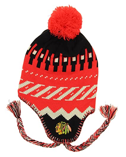 39e9a073e29 Image Unavailable. Image not available for. Color  NHL Youth Chicago  Blackhawks Hawks Knit Faceoff Tassel Beanie ...