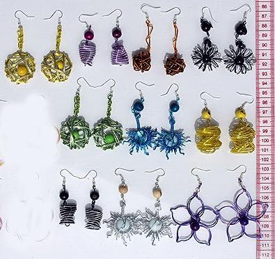 62157149894e Lot 10 pares de aretes artesanales de metal y semillas
