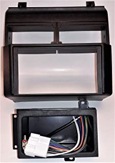 double din dash kit, harness, antenna adapter and pocket for installing a  new radio