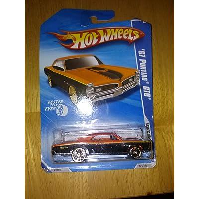 Hot Wheels '67 Pontiac GTO 6/10 Faster than ever 2010 134/240 (orange): Toys & Games