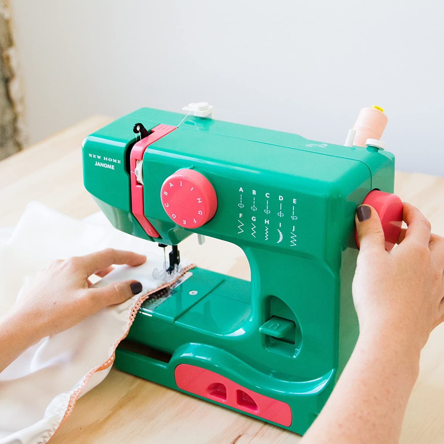 10-Stitch Portable Compact Sewing Machine with Free Arm only 5 pounds Easy-to-Use Janome Graceful Gray Basic