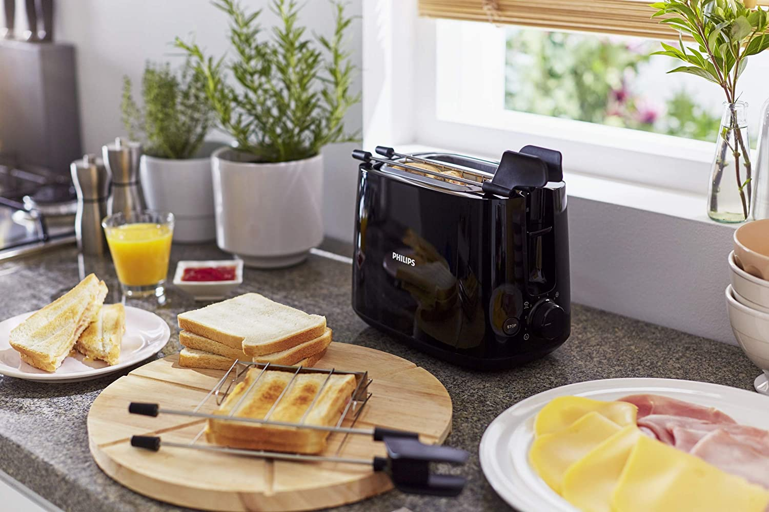 The Pop-up toaster with toasted breads, chutney and a glass of pineapple juice.