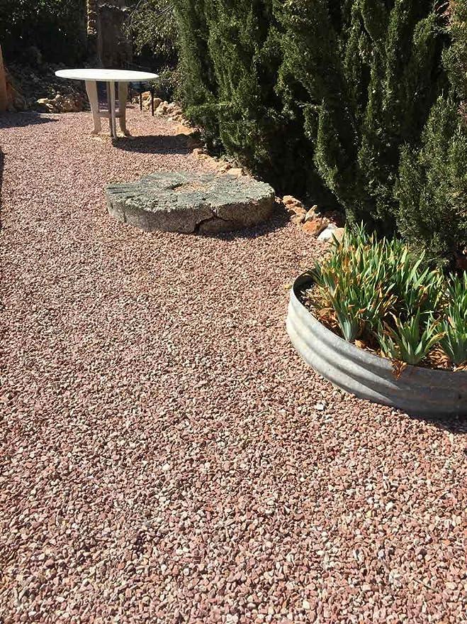 Grava roja mármol. Grava decorativa para el jardin en sacas de 1500kg. Disponible en formato 12-20mm.: Amazon.es: Jardín