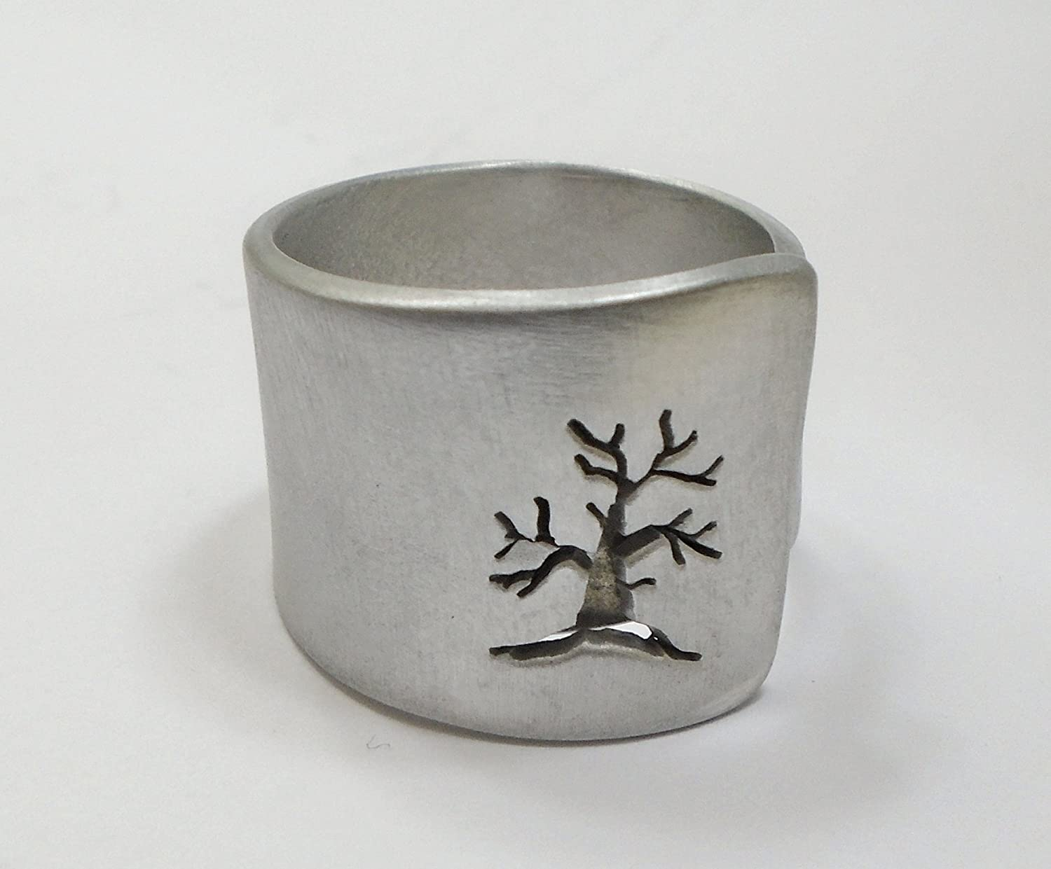 Open aluminum band ring with perforated tree perpendicular to the ring, and custom text.