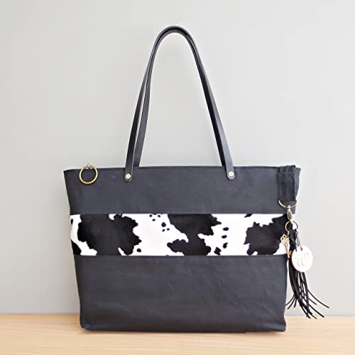 afb68971132d Handcrafted Zipper Waxed Canvas Tote Bag with a Faux Fur Cow Accent and  Leather Straps in Black