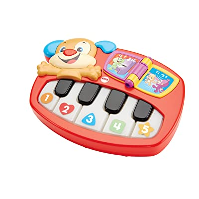 Fisher-Price Puppy's Piano by Fisher-Price: Juguetes y juegos