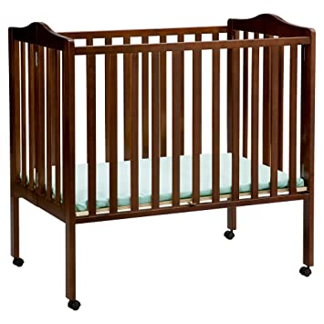 amazon com delta children folding portable mini crib with mattress