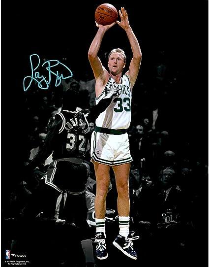 1d3558afc44 Larry Bird Boston Celtics Autographed 11 quot  x 14 quot  Shooting over Magic  Johnson Spotlight Photograph