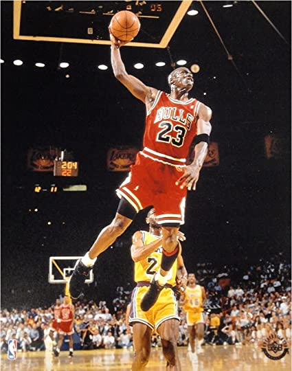 4a3d1c18be91 Amazon.com  Michael Jordan Unsigned 8x10 Photo Chicago Bulls Glide Dunk VS  Lakers  Sports Collectibles