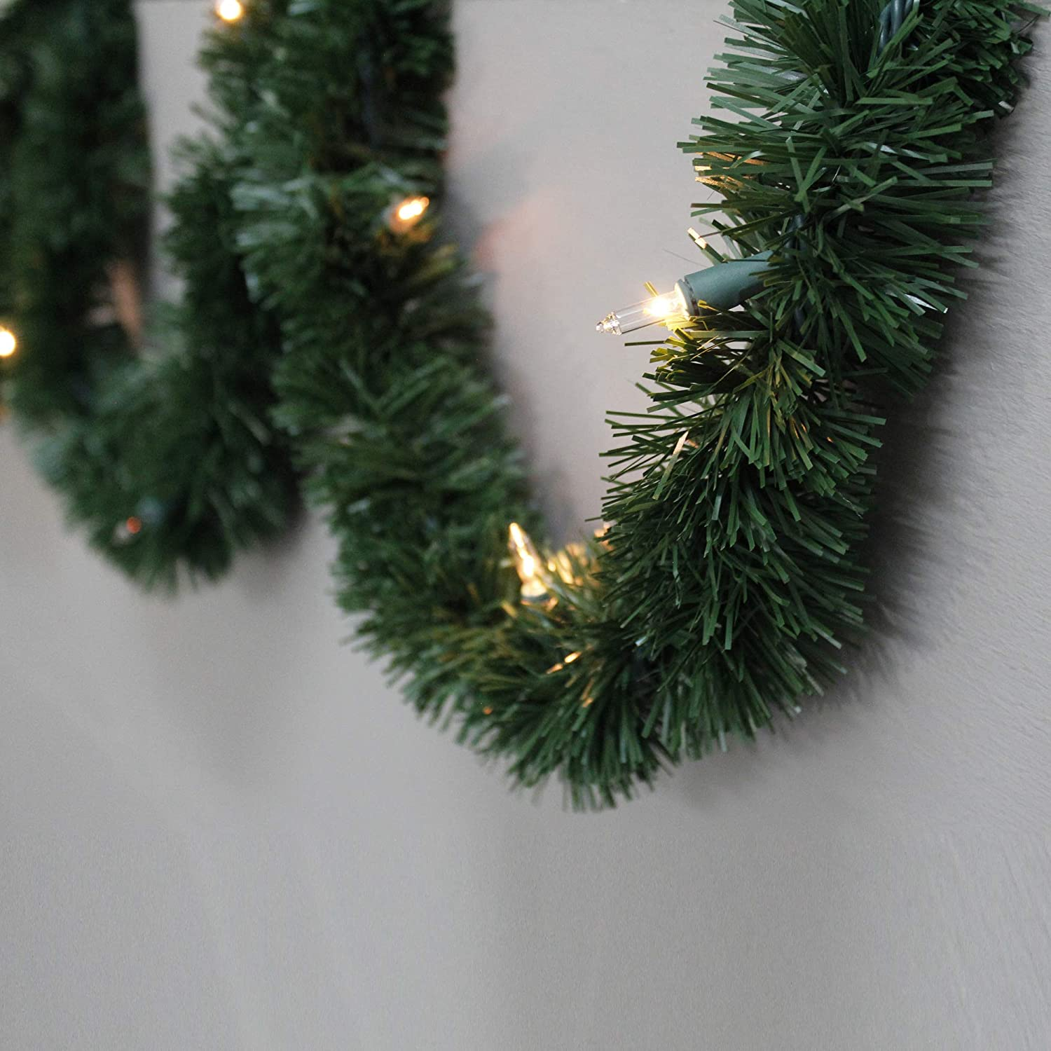 Brite Star 12-Feet Direct Plug in Lighted Pine Garland with 35 Count Clear Mini Lights