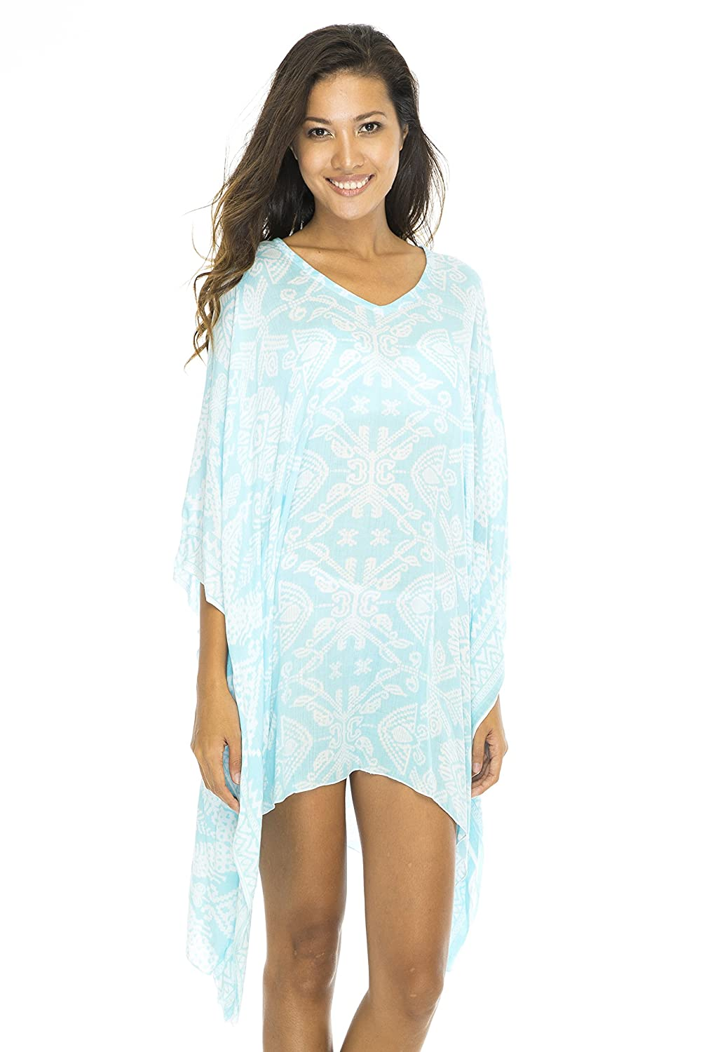 acd328d5f7 100% Rayon Exotic ikat tile print creates an enticing island vibe on this  Short Bikini Swim Caftan Poncho; traditional Indonesian design makes an ...