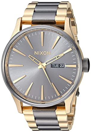 ab57cacd84e Amazon.com  Nixon Sentry SS Gunmetal Gold Classic Men s Watch (42mm. Gold    Gunmetal Face Gold   Gunmetal Stainless Steel Band)  Watches