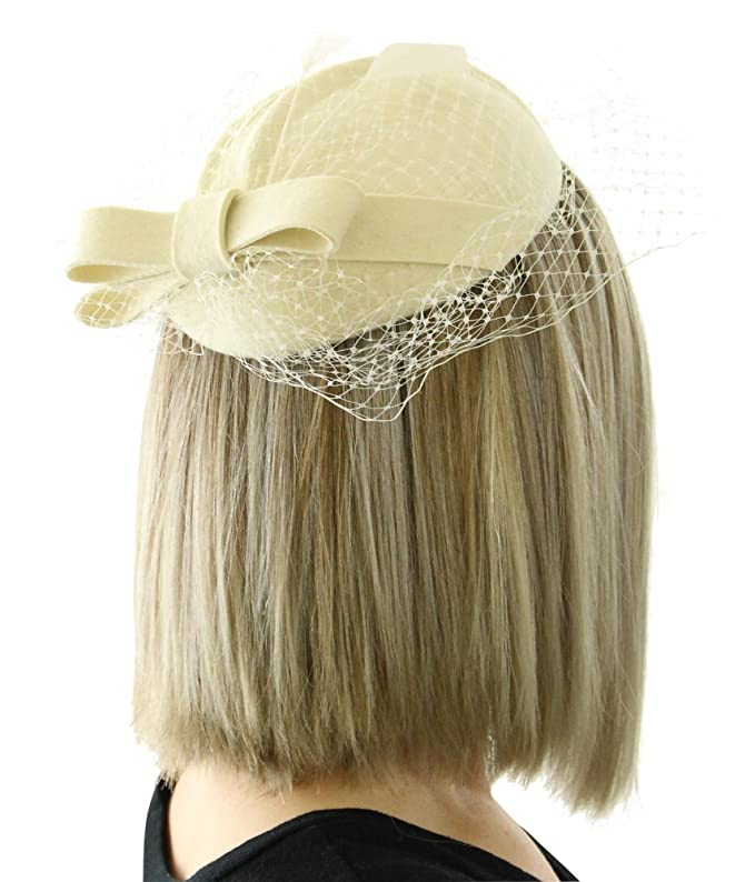 1950s Style Hats for Sale The Minnie Pillbox Fascinator Hat with Bow and Veil and Hair Clip for Women $29.99 AT vintagedancer.com