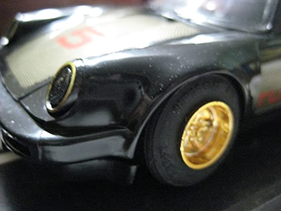 Amazon.com: Scalextric (Great Britain Black Porsche 930 (Turbo) Plastic Slot Car 1:32 Nib: Toys & Games