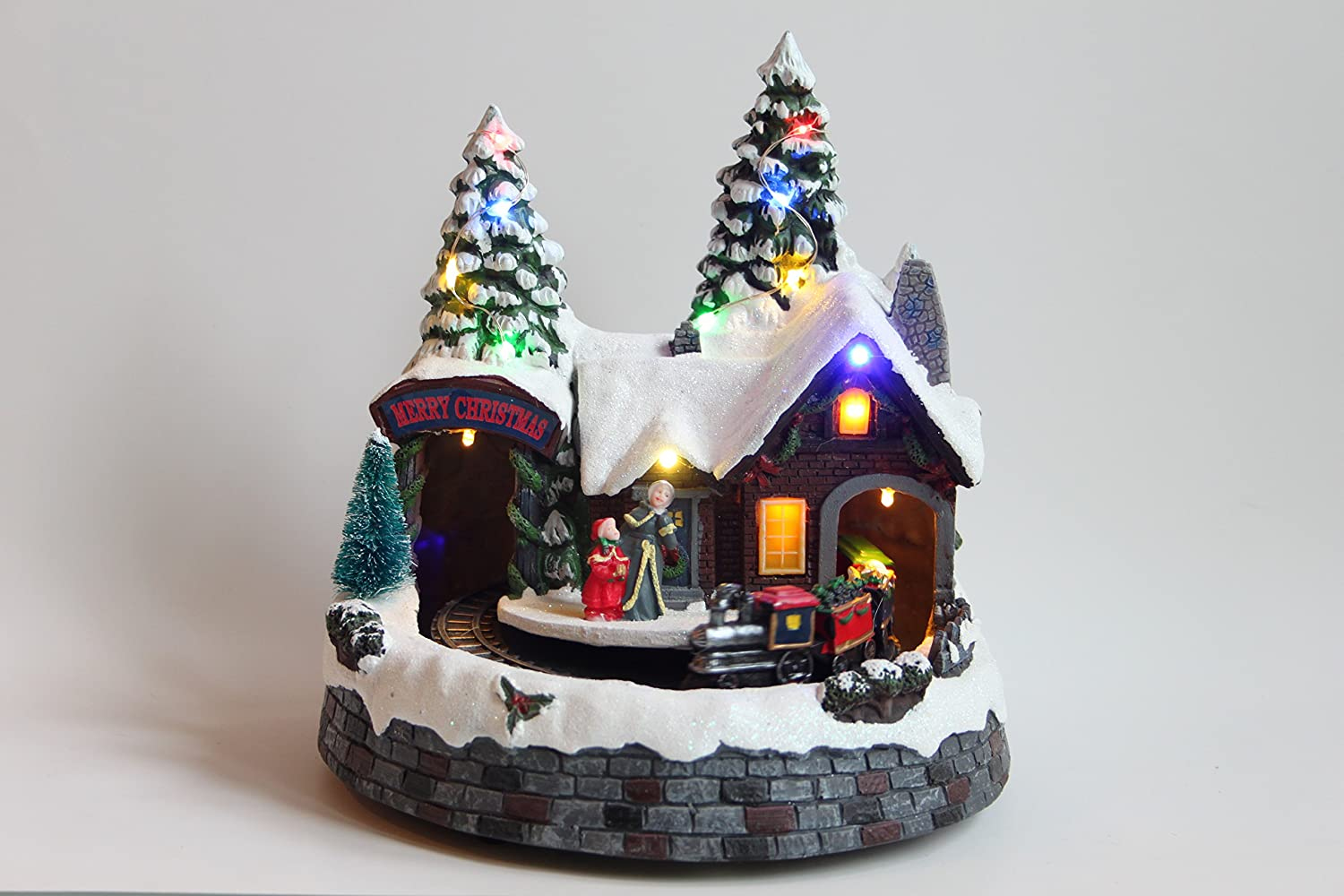 Festive Led Light up Musical Christmas Train Station Scene with Revolving Train (22cm Clock Tower)